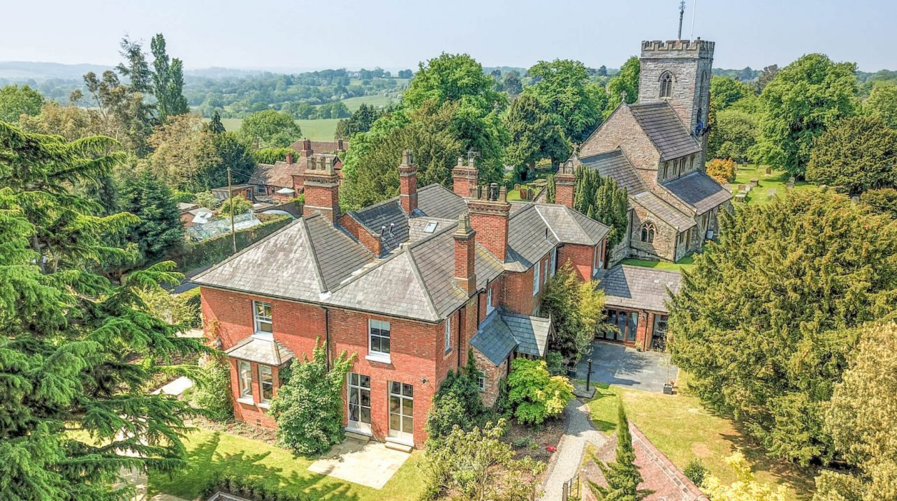 Drone Aerial Picture of Large House by Church